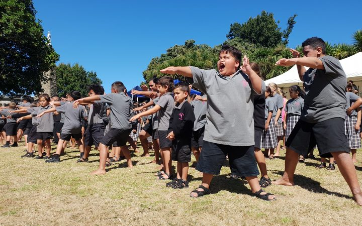 Students at Te Kura o Kokohuia perform a haka.