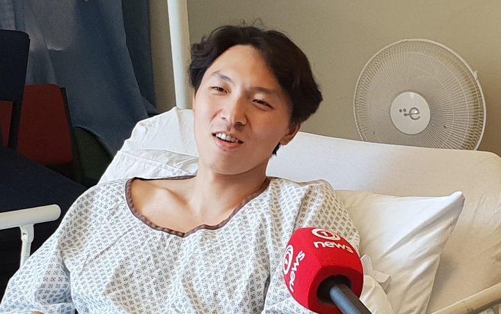 Son Jungho talks to media from his hospital bed.