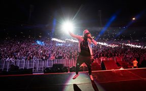 Eminem's Wellington concert last night drew a record crowd of more than 46,000 to Westpac Stadium.