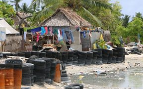 Villagers have resorted to using tires and barrels for protection from the sea
