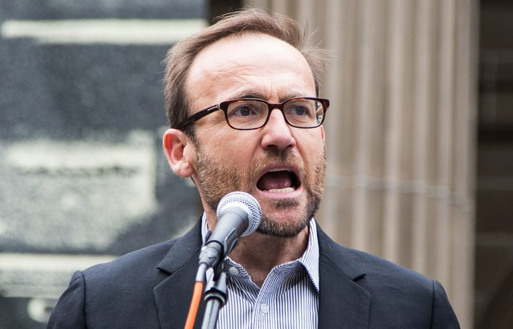 Green Party MP Adam Bandt addresses the crowd during a protest against US President Donald Trump and Australian Prime Minister Malcolm Turnbull and their Immigration and Refugee policies in Melbourne.