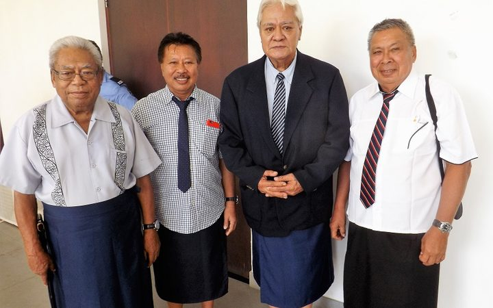 Faamausili Moli Malietoa (second from right) with matais of Malie outside the court room