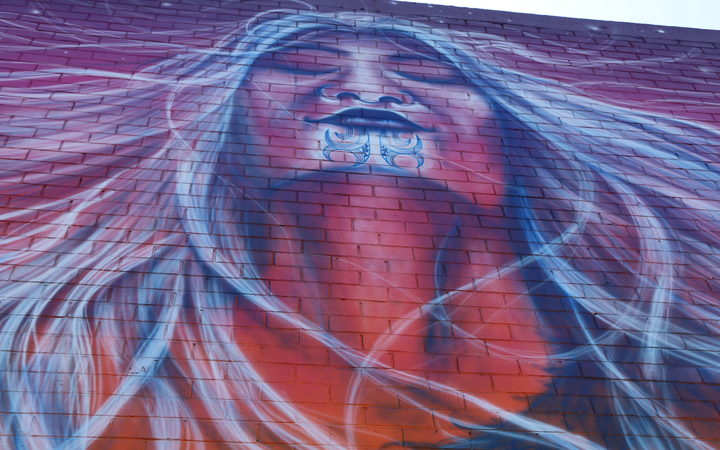 A mural depicting Hineteiwaiwa - the Māori goddess of weaving and fertility by artist Bobby MacDonald in Onehunga.