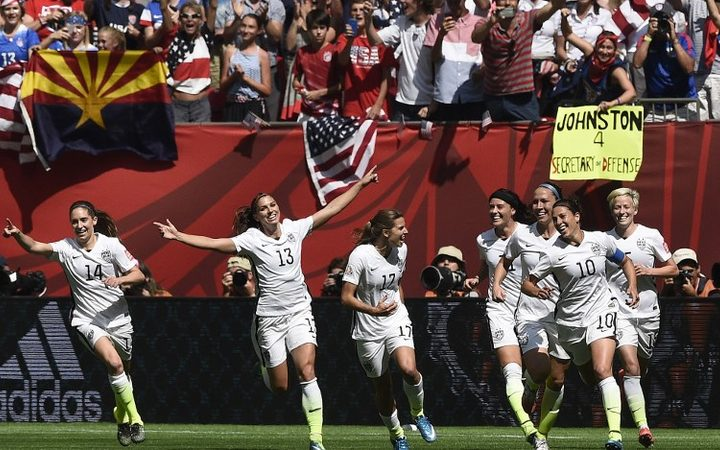 (FILES) In this file photo taken on July 05, 2015 USA midfielder Carli Lloyd (10) celebrates her goal with teammates during the final football match between USA and Japan during their 2015 FIFA Women's World Cup at the BC Place Stadium in Vancouver. )