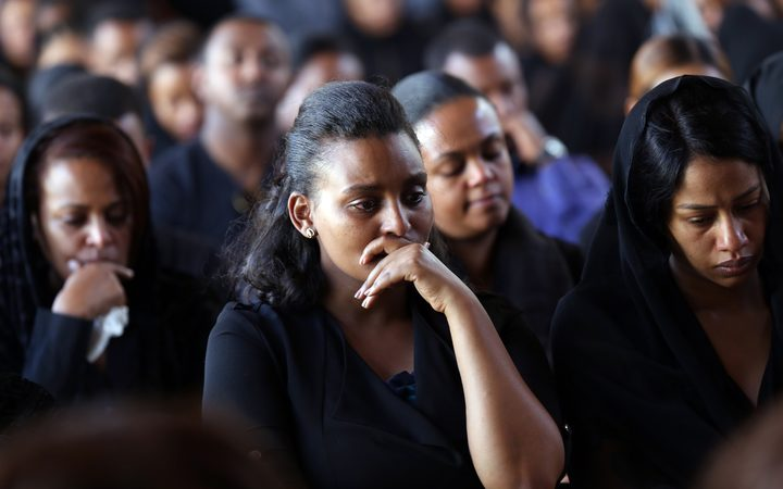 Colleagues mourn during a memorial ceremony held for the crew who died in the Ethiopian Airlines crash in Addis Ababa, Ethiopia.