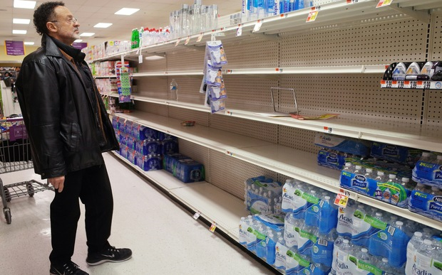 shopper looks at the bottled water section at a supermarket ahead of an expected blizzard.