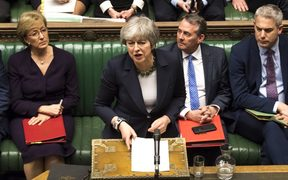 A handout photograph released by the UK Parliament on March 13, 2019 shows Britain's Prime Minister Theresa May responding to the result of a vote in the House of Commons in London