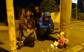 Malik Ricks (Dad), Suki Hickling (Mum) Frida Ricks (daughter) and Tahi Ricks who laid flowers and lit candles at cordon by Linwood mosque this evening - March 15 2019
