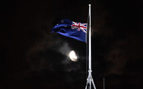 The flag is flown at half-mast at Parliament building following the terrorist shooting in Christchurch.