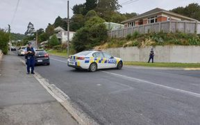 Police at the scene on Somerville St in Dunedin earlier today. Photo / Tim Brown