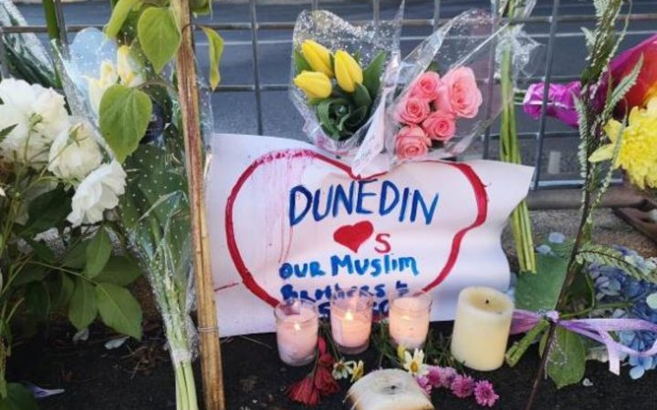 Flowers and candles were left outside Dunedin's Al Huda mosque this morning.