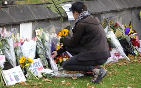 Flowers are laid at the special wall set up beside the Christchurch Botanical gardens.
