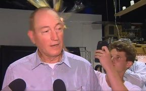The moment a young man broke an egg on Australian Senator Fraser Anning's head.