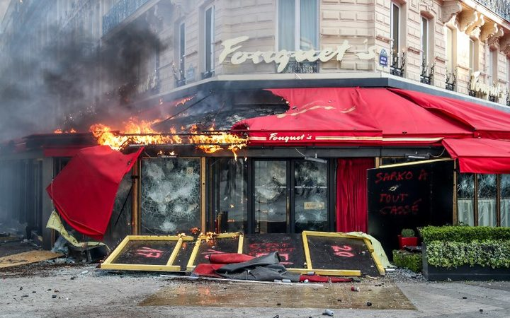 Ban on yellow vest protests on Champs-Elysees following rioting
