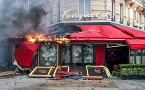 A restaurant on fire during clashes between riot police and 'gilets jaunes' on the Champs-Elysees, Paris on 16 March.