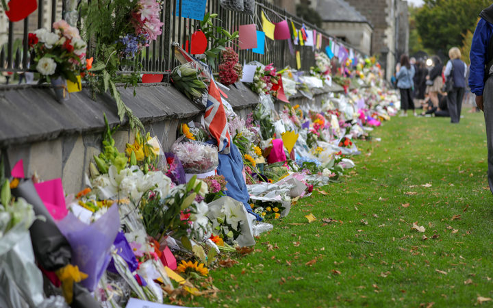 Christchurch Botanic Gardens wall with hundreds of flowers laid in memory of those lost in the mosques shooting