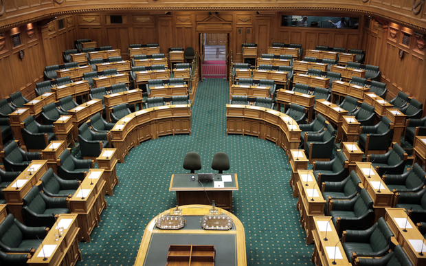 Seats in the empty debating chamber at Parliament