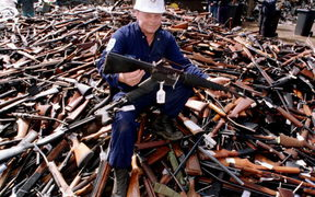 Norm Legg, a project supervisor with a local security firm, holds up an armalite rifle which is similar to the one used in the Port Arthur massacre and has been handed in for scrap 08 September in Melbourne.