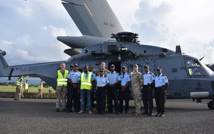 Australian and New Zealand defence force personnel with Solomon Islands Police officers shortly after landing at the Honiara International Airport. March 2019