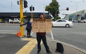 Shay Kenny vows to stand holding his sign for eight hours a day for at least the next week.