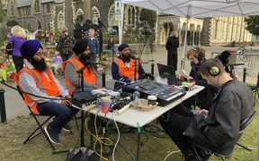 Sikh Sangat Trust members talking to Susie Ferguson in Christchurch.