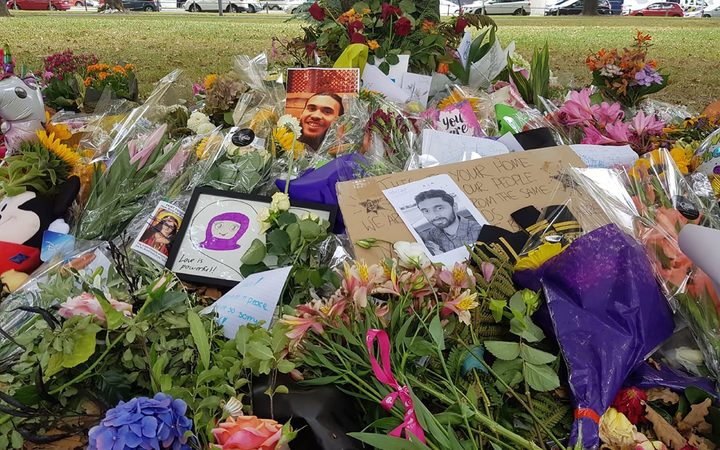 Pictures of Christchurch mosques attack victims sits above flowers at a memorial site near the Al Noor mosque.