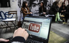 Laptop showing YouTube logo being used in Turkey.