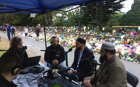 Susie Ferguson, Mohamed Hassan, Omar Suleiman and Qasim Rashid Ahmad discuss issues around the Christchurch mosque attacks, from the RNZ special broadcast outside the Botanic Gardens.