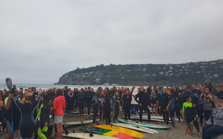 Hundreds of Christchurch surfers have paid tribute to the victims of last week's terror attacks with by paddling out at Sumner Beach.