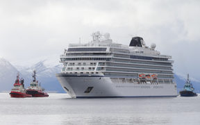 The cruise ship Viking Sky, that ran into trouble in stormy seas off Norway, reaches the port of Molde under its own steam on March 24, 2019.
