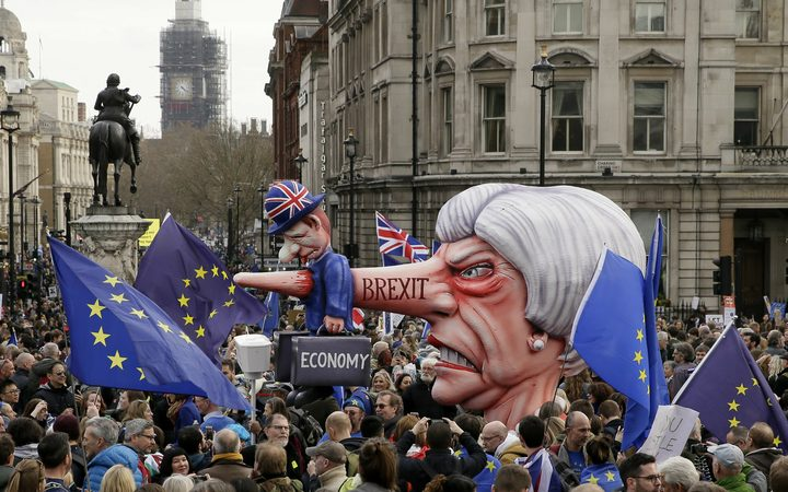 An effigy of British Prime Minister Theresa May is wheeled through Trafalgar Square during a Peoples Vote anti-Brexit march in London, Saturday, March 23, 2019.