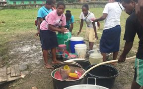 Food pre by volunteers for displaced Papuan villagers in Wamena.