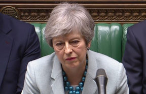 Britain's Prime Minister Theresa May listen as opposition leader Jeremy Corbyn speaks in the House of Commons in London on March 25, 2019 after May outlined the next steps that parliament will take in the Brexit process.