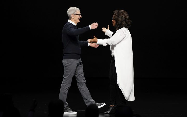 Apple CEO Tim Cook and Oprah Winfrey during an event at the Steve Jobs Theatre to unveil its new streaming platform. March 25, 2019, in Cupertino, Calif.