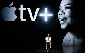 Oprah Winfrey speaks at the Steve Jobs Theatre during the announcement of Apple's new streaming service.