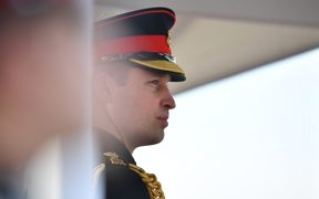 Britain's Prince William, Duke of Cambridge representing Britain's Queen Elizabeth II inspects the graduating officer cadets during the Sovereign's Parade at the Royal Military Academy, Sandhurst, southwest of London on December 14, 2018.