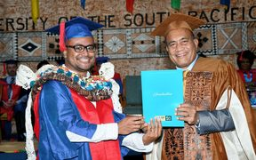 PhD in Climate Change graduate, Jale Samuwai, is conferred with the award by the H.E Taneti Maamau, Chancellor of USP