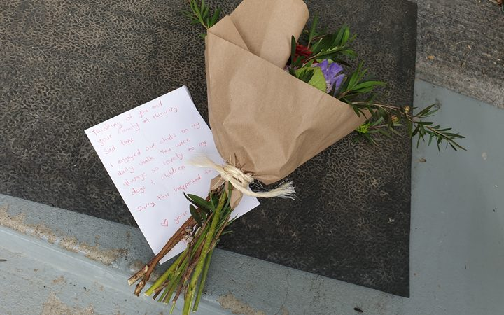 Flowers on the doorstep of the St Martin's house where Troy Dubrovskiy lived.