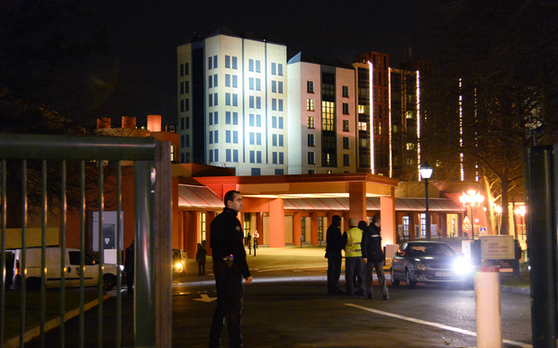 Police stand guard at the Dinseyland hotel where a man was arrested.