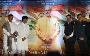 "Actors and directors pose with posters of the upcoming Bollywood film  ""PM Narendra Modi"" - a biopic on Indian Prime Minister Narendra Modi. Actor Vivek Oberoi (2R) portrays the Indian Prime Minister in the film."