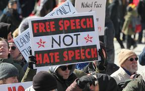 A pro-Muslim protestor carrying a sign saying 'Free Speech NOT Hate Speech' as opposing groups of protesters clashed over the M-103 motion to fight Islamophobia during pro-Muslim and anti-Muslim demonstrations in downtown Toronto; Ontario; Canada; on March 04; 2017.