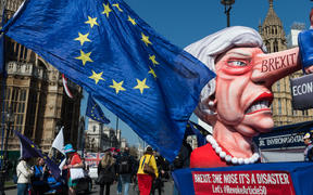 A float with a caricature of British Prime Minister Theresa as Pinocchio stands outside the Houses of Parliament during pro-EU protest on 01 April, 2019 in London, England.