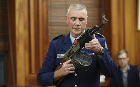Police officer Paddy Hennan demostrates illegal gun modifications