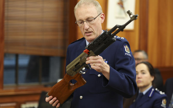 Acting Superintendant Michael McIlraith demonstrates how semi-automatic weapons can be illegally modified