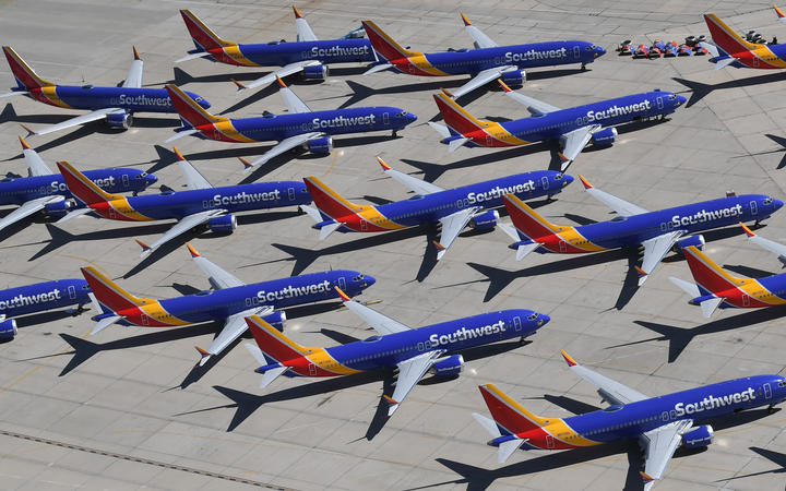 Southwest Airlines Boeing 737 MAX aircraft are parked on the tarmac after being grounded.