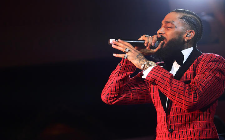 Nipsey Hussle performs onstage at the Warner Music Pre-Grammy Party in February.