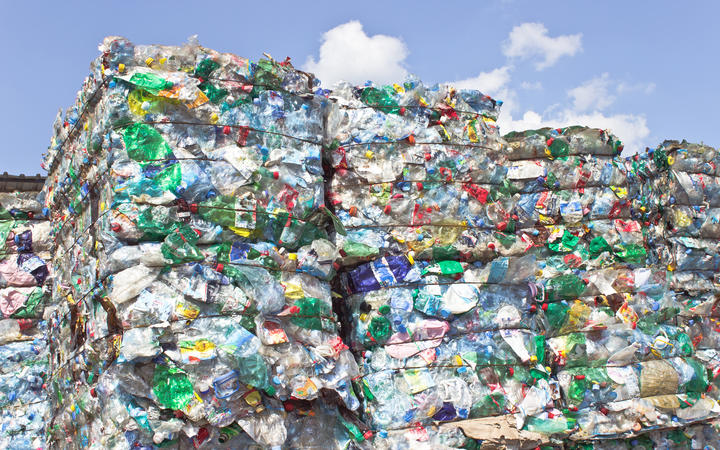 Stack of plastic bottles for recycling.