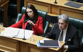 Jacinda Ardern and Winston Peters listen to a question