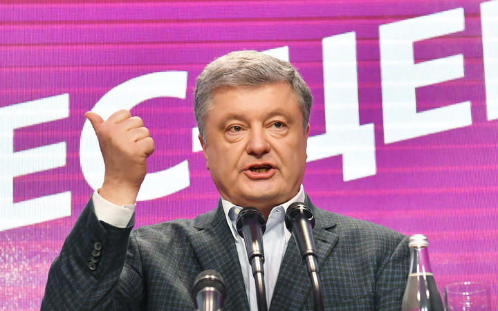 Ukrainian incumbent president Petro Poroshenko delivers a speech at his campaign headquarters in Kiev.