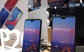 Huawei's mobile phones are displayed at a telecoms service shop in Hong Kong, Friday, March 29, 2019.